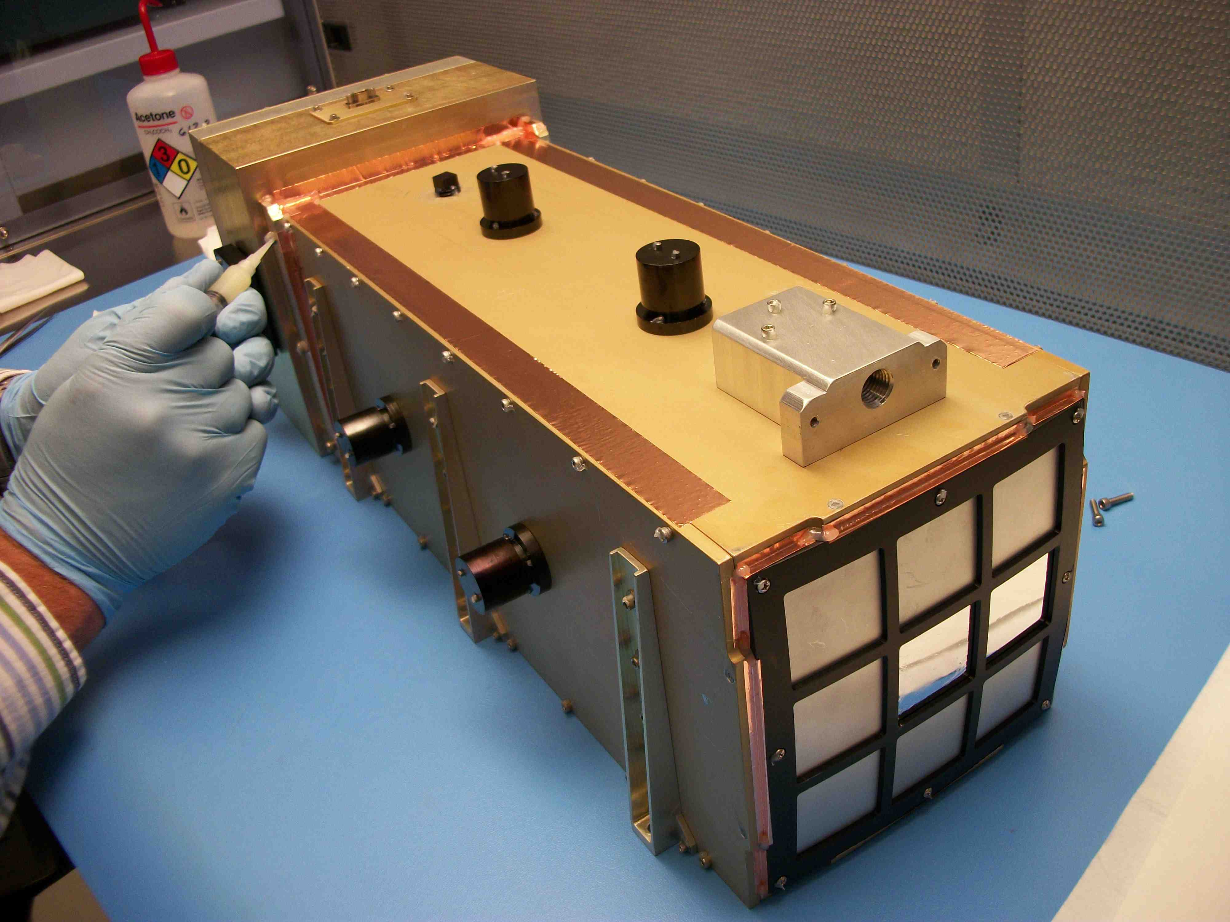The integrated instrument prototype with the optics assembly at the front and the electronics box in the back. Credit-NASA